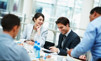 Successful and happy business people sitting for a meeting